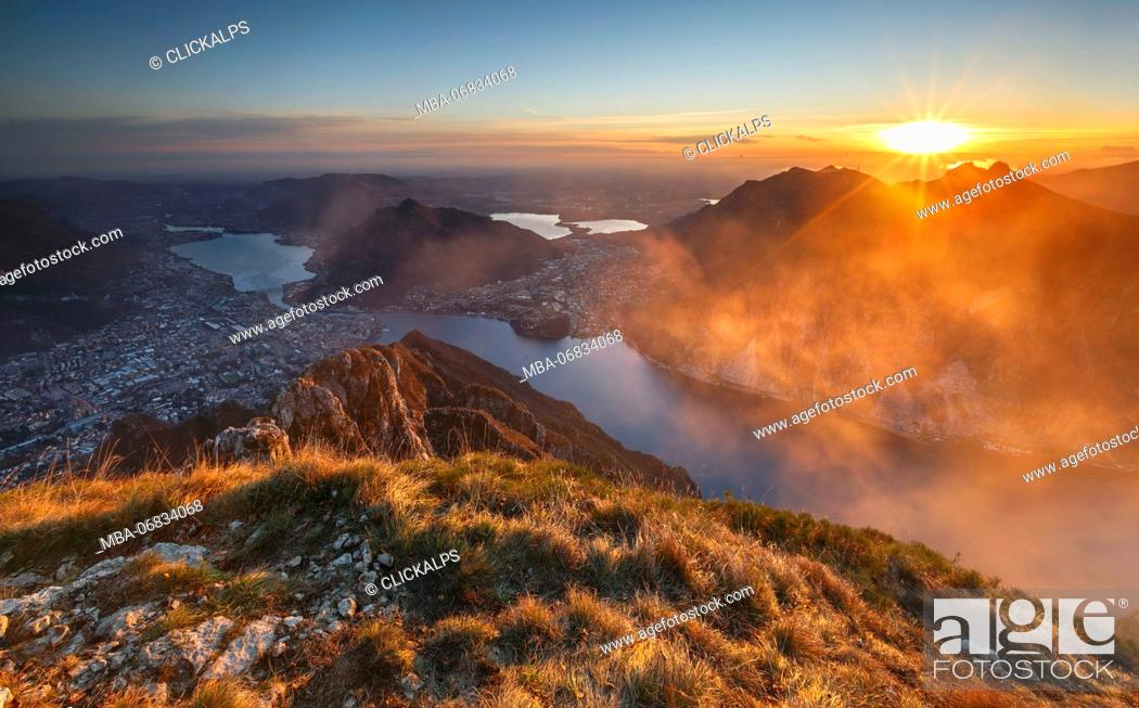 Stock Photo: Red and foggy sunset above Lecco, lake Como, Lombardy, Italy, Europe.