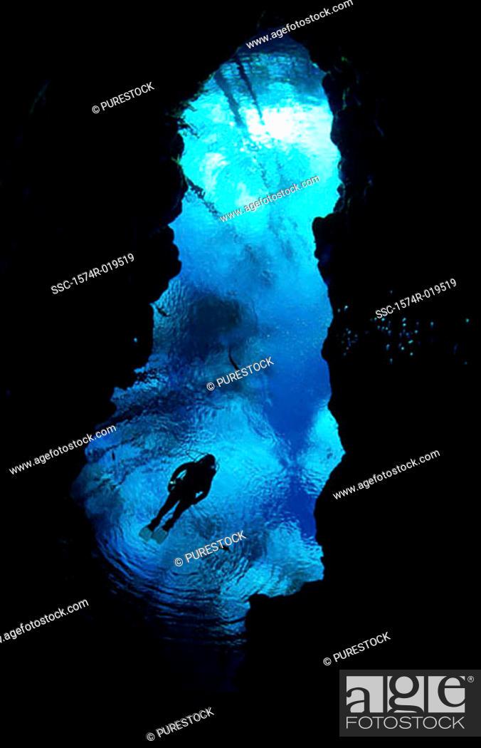 Stock Photo: Scuba diving near underwater cave.