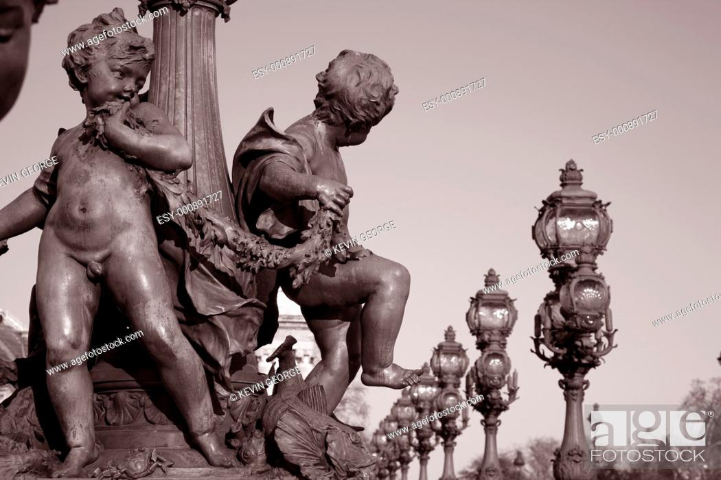 Stock Photo: Figures on the Alexandre III Bridge, Paris, France.
