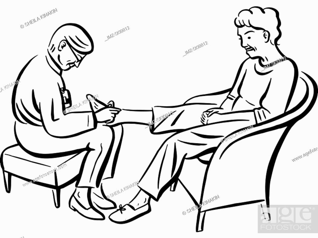 Stock Photo: A woman giving a foot massage.
