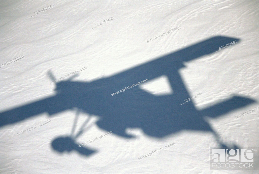 Stock Photo: Airplane shadow over snow, Aoraki/Mount Cook National Park, South Island, New Zealand.