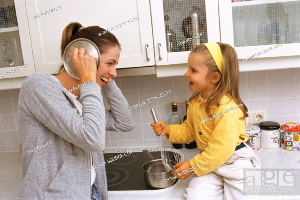 Stock Photo: Mother and daughter in kitchen.