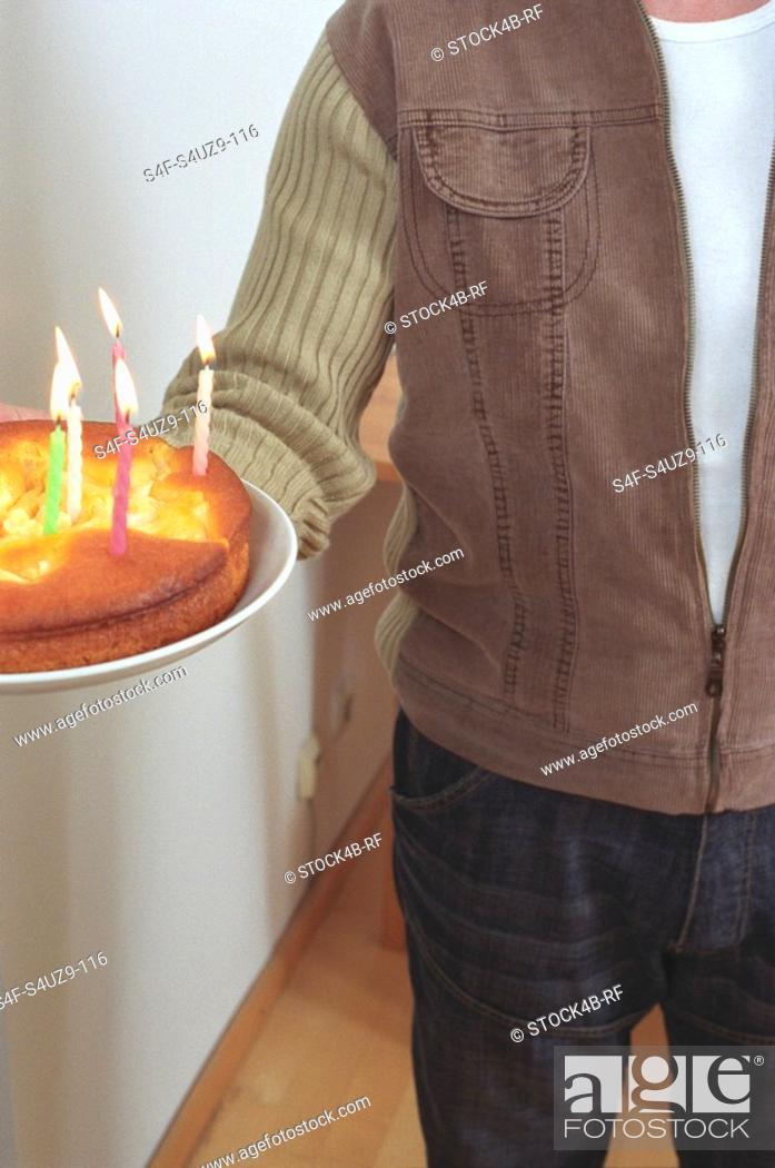 Stock Photo: Man holding a Birthday Cake cropped.