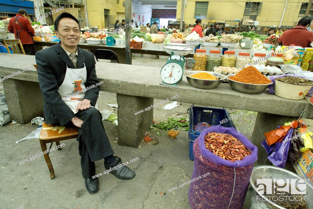 Stock Photo: A chinese seller of spices at the Ali city market  Ali  Ngari prefecture  Tibet  China  Asia.