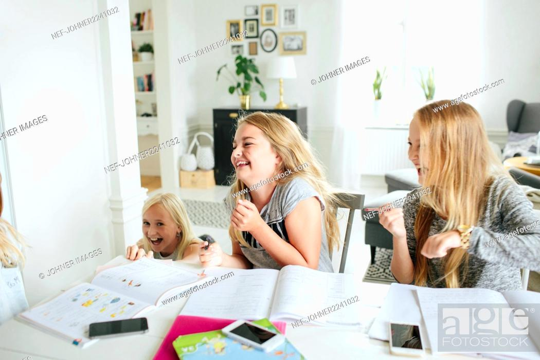 Stock Photo: Happy girls learning together.