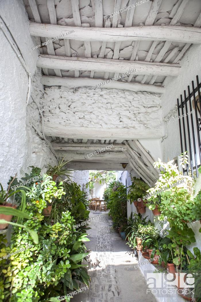 Stock Photo: Traditional alley called tinao . Unique feature architecture that connects buildings on both sides of narrow village streets. Capileira town.