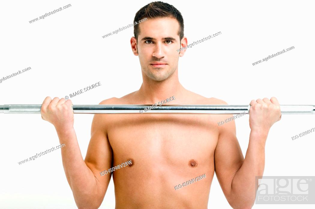 Stock Photo: Young man weightlifting.