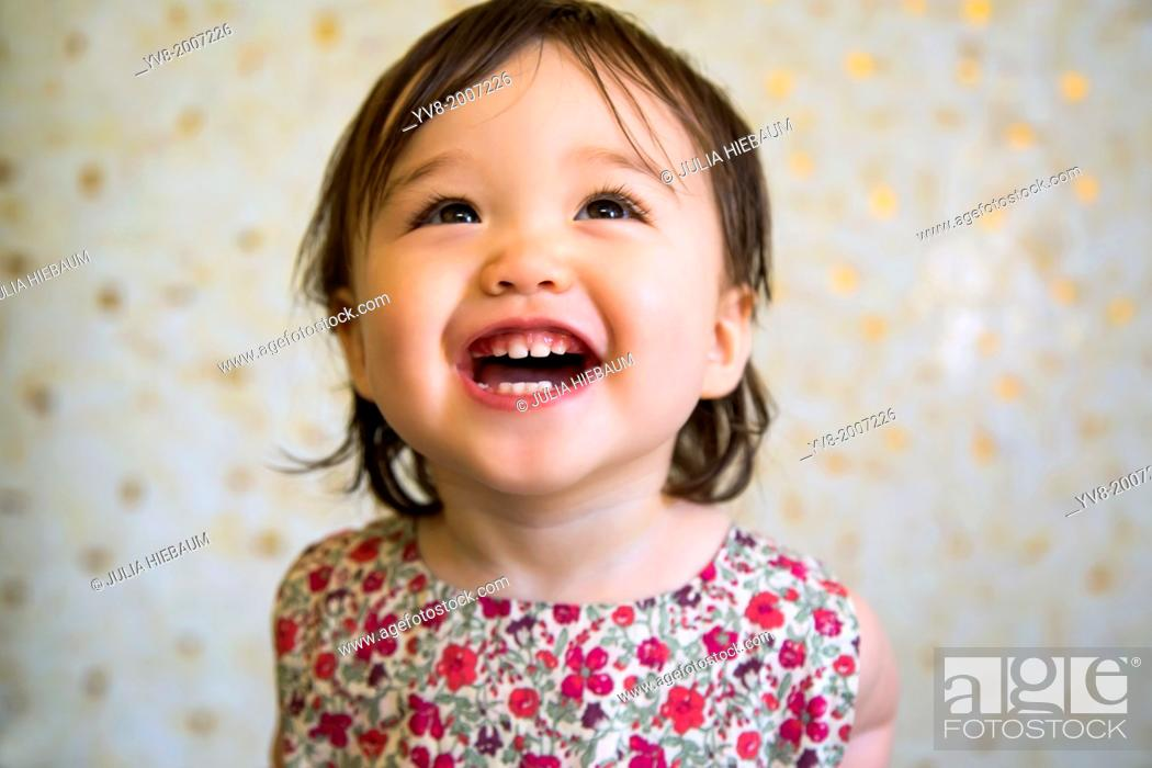 Stock Photo: 16 months old smiling baby girl.