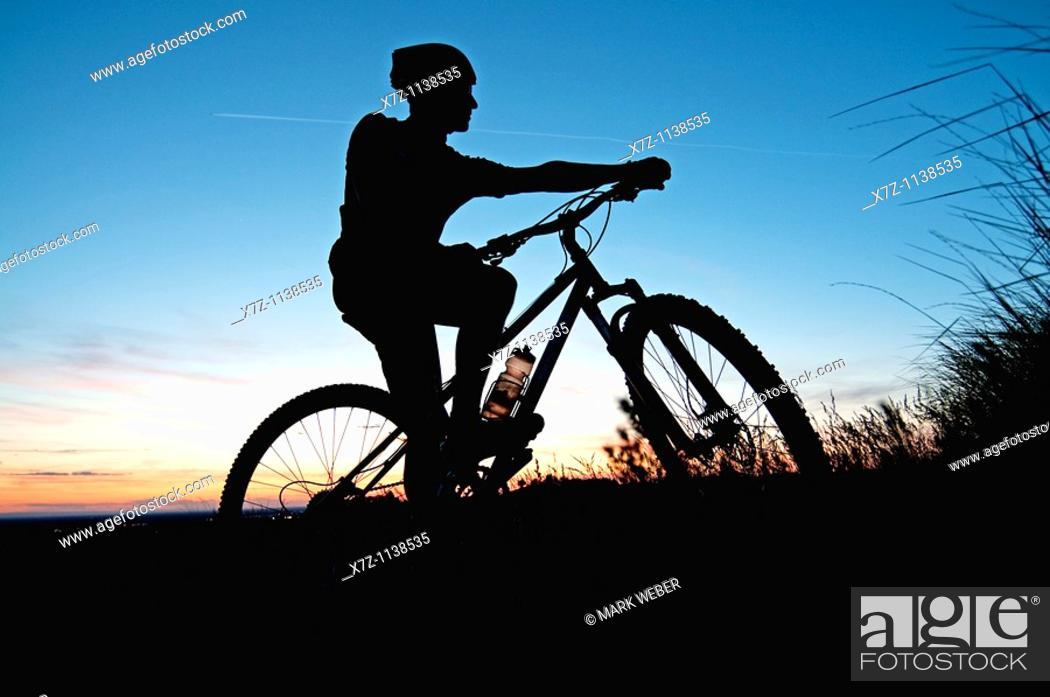 Stock Photo: Ridge to Rivers Mountain Bike Ranger mountain biking high in the Boise foothills near the city of Boise in southwestern Idaho.