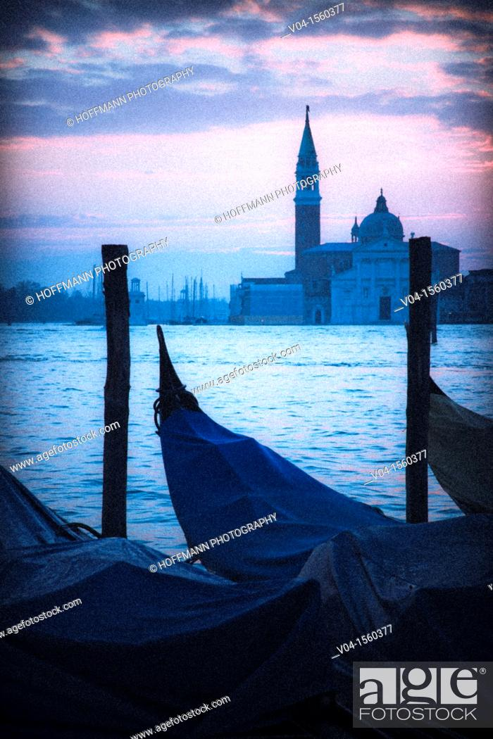Stock Photo: Mystical view of San Giorgio Maggiore with gondolas in the foreground, Venice, Italy, Europe.