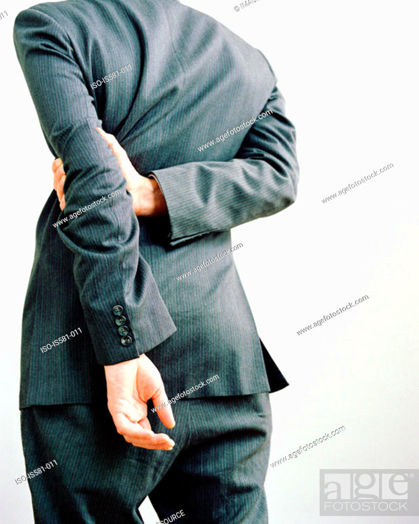 Stock Photo: Businessman with hands behind back.