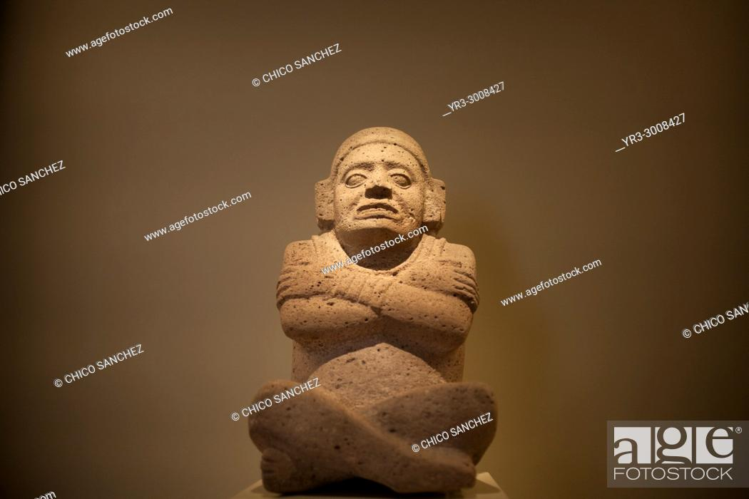 Stock Photo: An sculpture of a man sitting and with his arms crossed is displayed in Museo Amparo, in Puebla de los Angeles, Mexico.