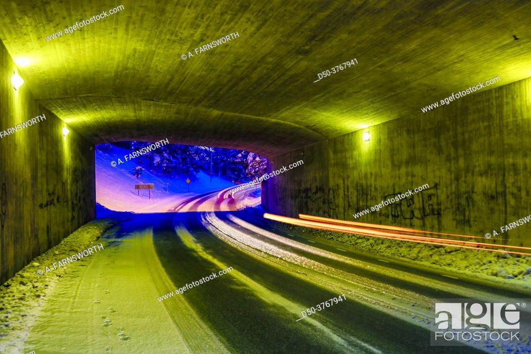 Stock Photo: Stockholm, Sweden An illuminated tunnel in the winter and traffic streaks.