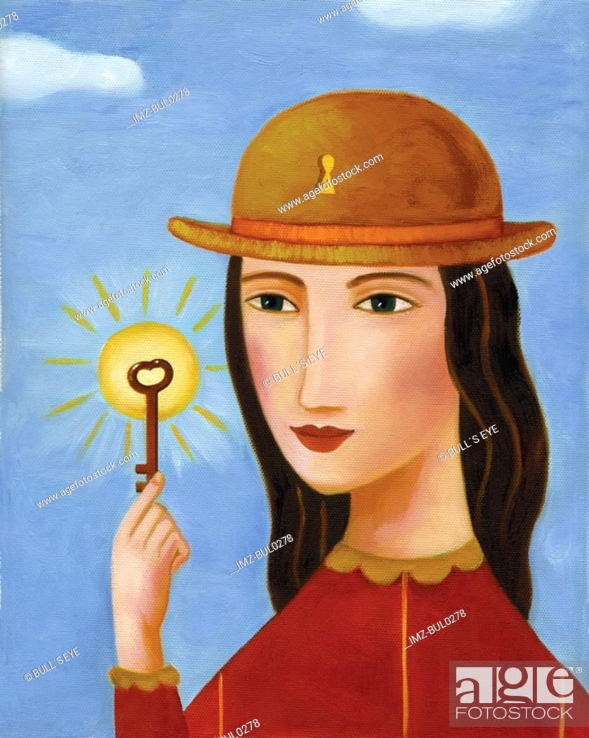 Stock Photo: Closeup of a woman holding a skeleton key.