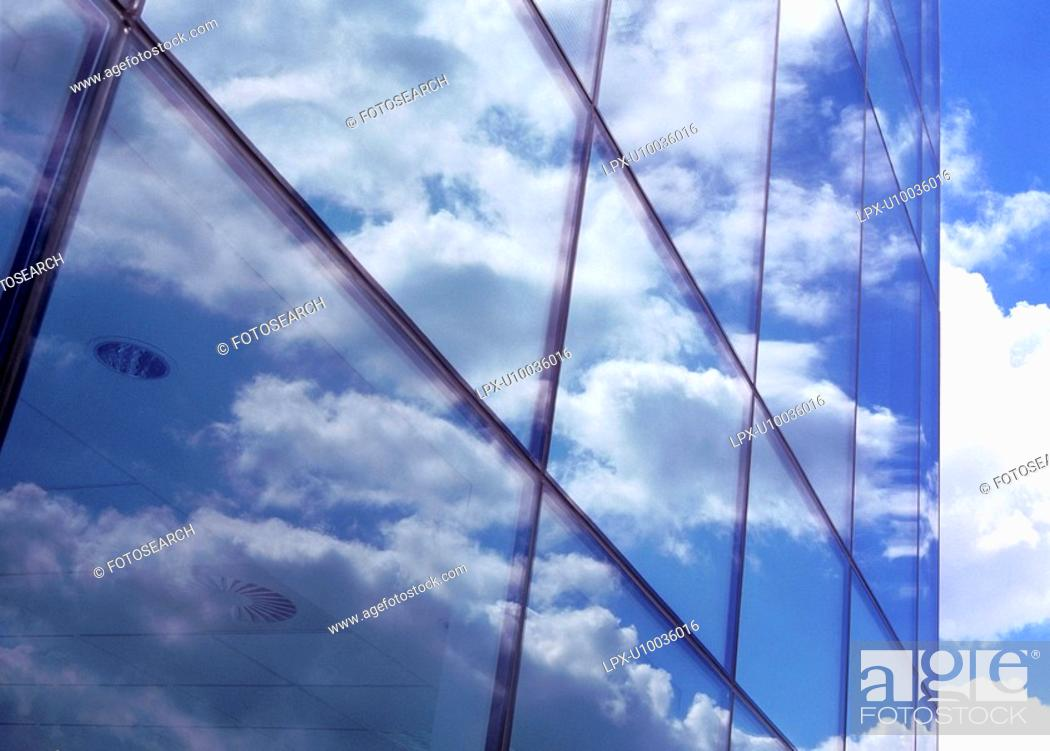 Stock Photo: Blue Sky and clouds reflected on building exterior.