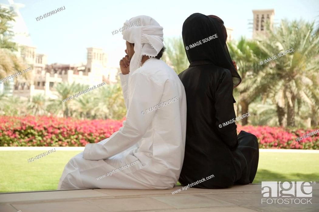 Stock Photo: Middle Eastern people sitting side by side.