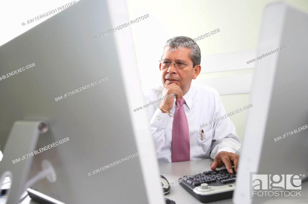 Stock Photo: Businessman using computer.