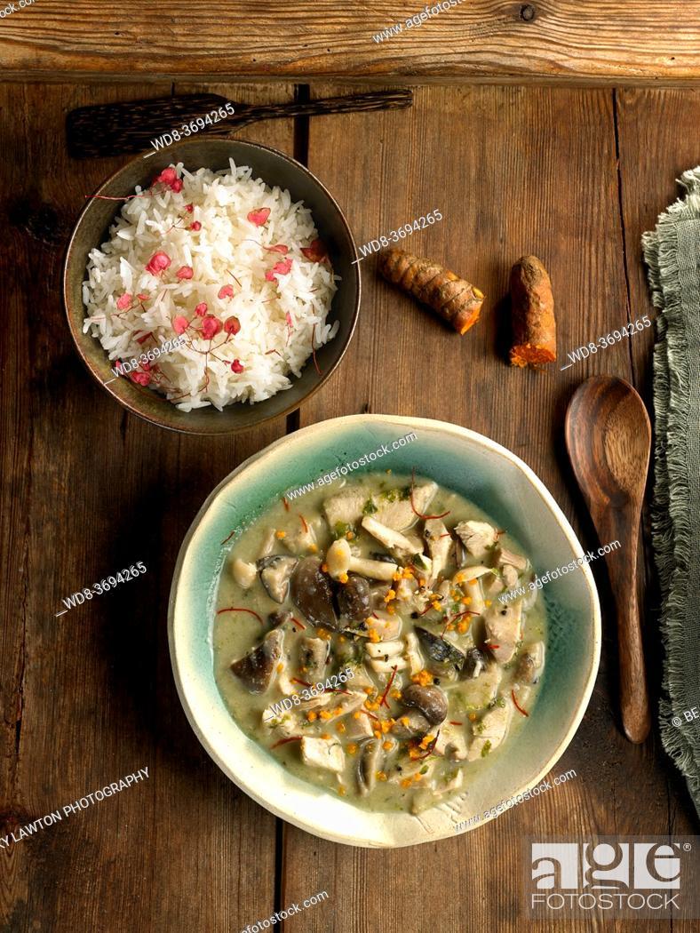 Stock Photo: creamy rice with cauliflower mushrooms and turkey.