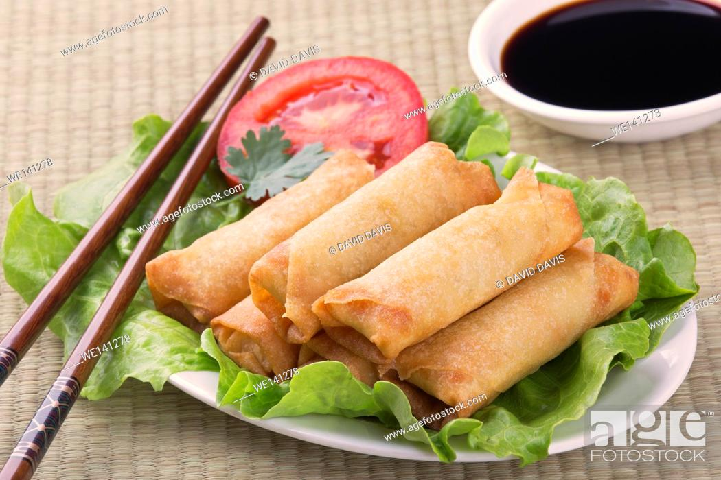 Stock Photo: Traditional Chinese Spring Rolls with a dipping sause of soy sause.