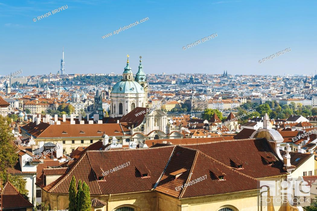 Stock Photo: Aerial view of cityscape and St. Nicholas Church in Prague, Czech Republic.