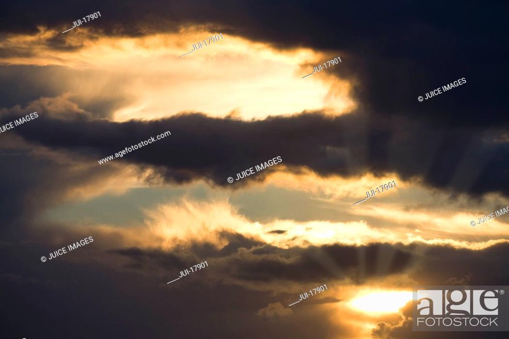 Stock Photo: Sun in cloudy sky.
