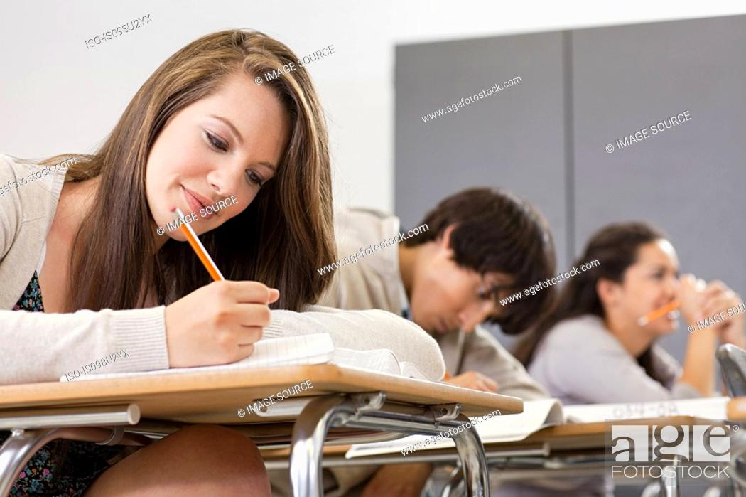 Stock Photo: High school students sitting in classroom.