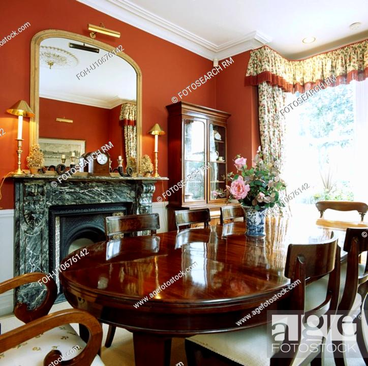 Antique Mahogany Table And Chairs In Red Dining Room With Gilt Mirror Above Black Marble Fireplace Stock Photo Picture And Rights Managed Image Pic Foh U10676142 Agefotostock