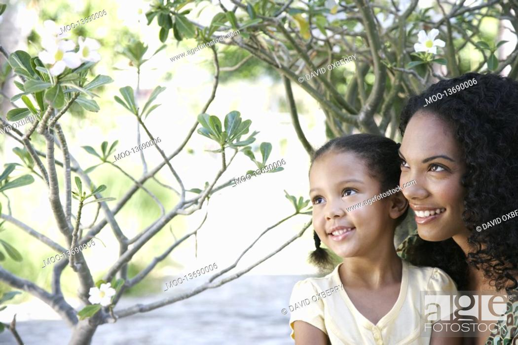 Stock Photo: Mother and daughter 5-6 years in garden.