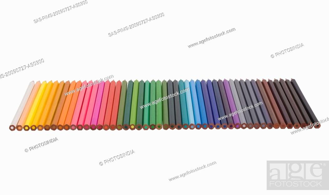 Stock Photo: Close-up of colored pencils in a row.