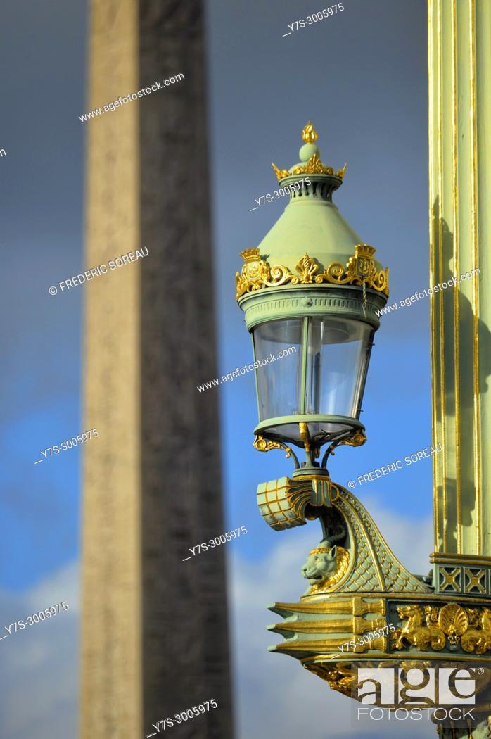 Stock Photo: Lamp post with obelisque on background, Place de la Concorde, Paris, France.