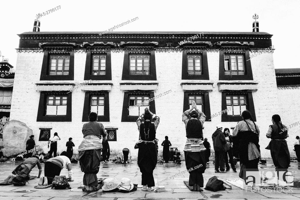 Stock Photo: Lhasa, Tibet - The view of many Pilgrims at the Jokhang Temple Square in the daytime.