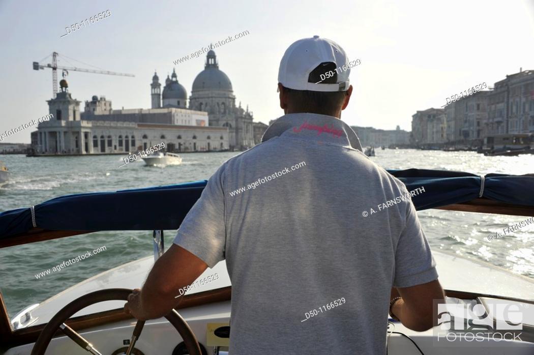 Stock Photo: Boat taxi driver, Venice, Italy.