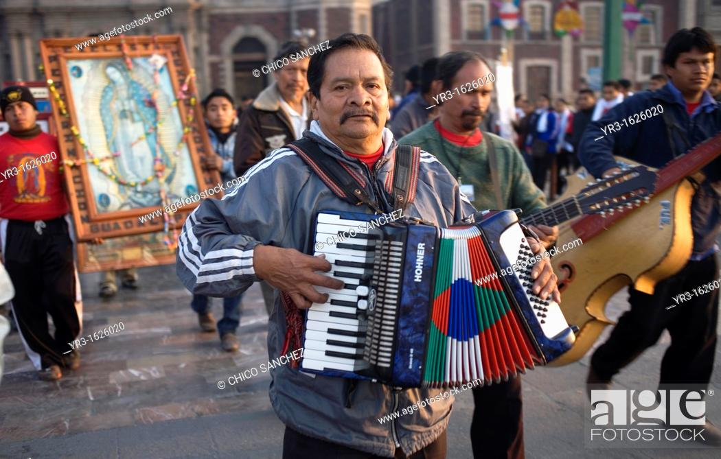 Stock Photo: Musicians play Mexican northern style music outside the Our Lady of Guadalupe Basilica in Mexico City, December 9, 2011  Hundreds of thousands of Mexican.