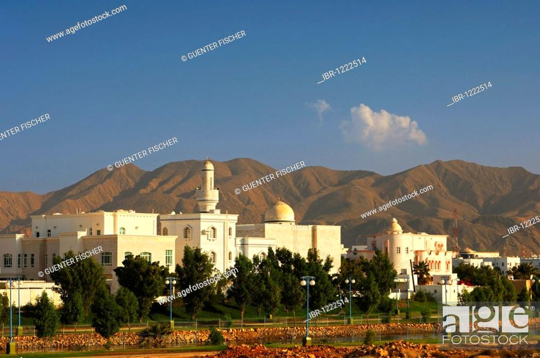 Stock Photo: New housing estate with mosque and minaret, in front of stark mountains, Muscat, Sultanate of Oman, Middle East.