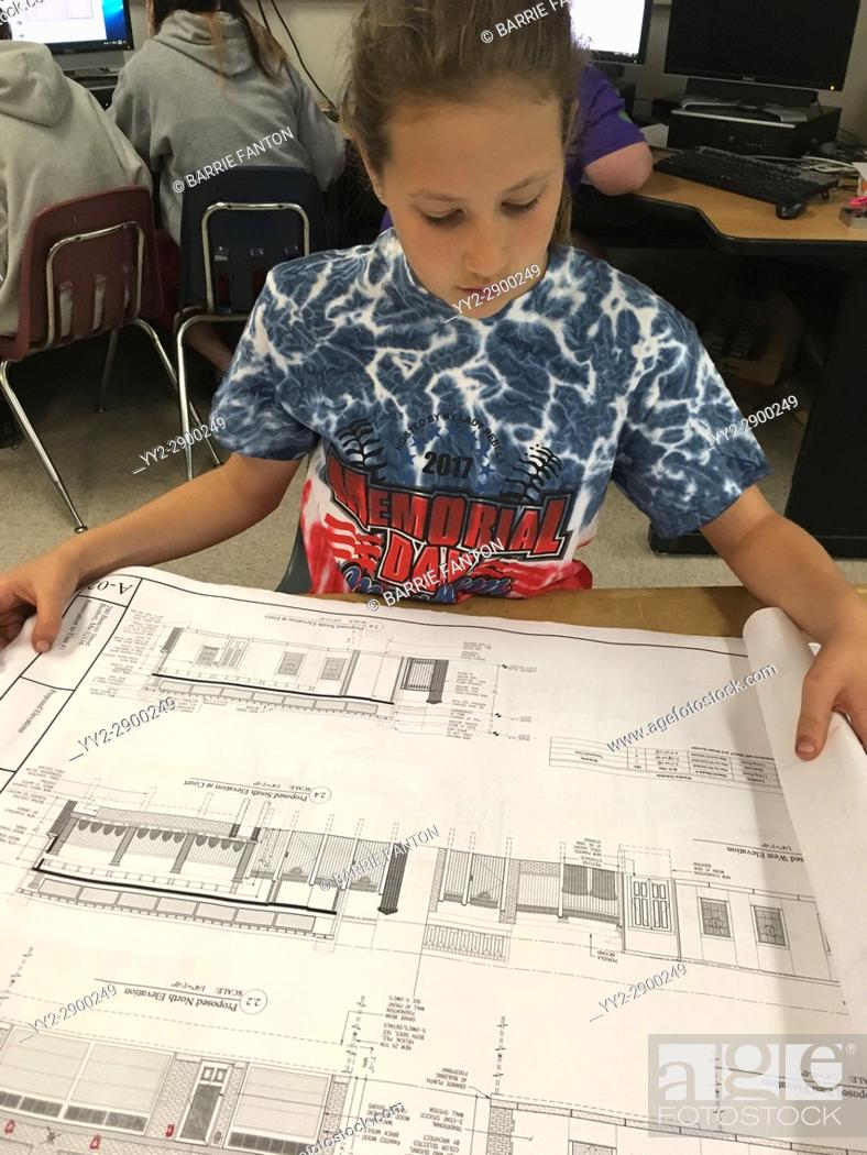 Imagen: 6th Grade Girl Looking at Architecture Plans, Wellsville, New York, USA.