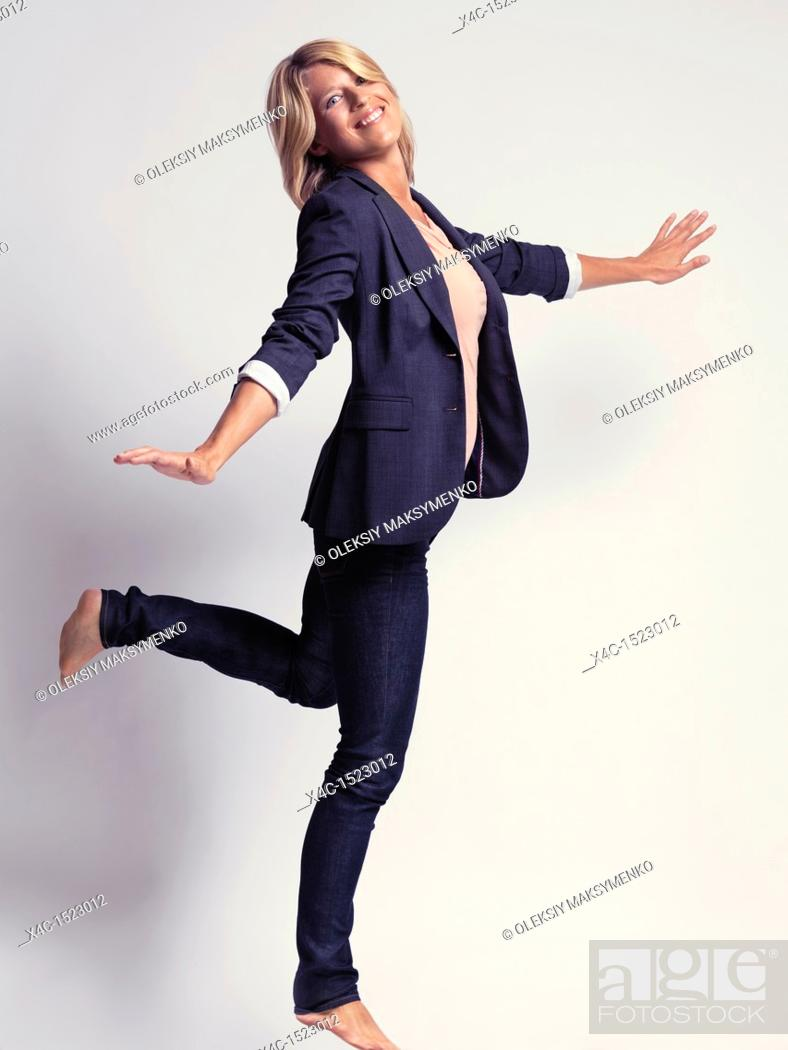 Stock Photo: With style dressed smiling young business woman.