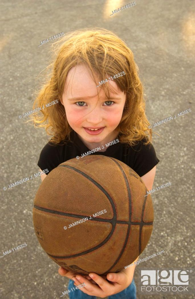 Stock Photo: Young girl holding a basketball.