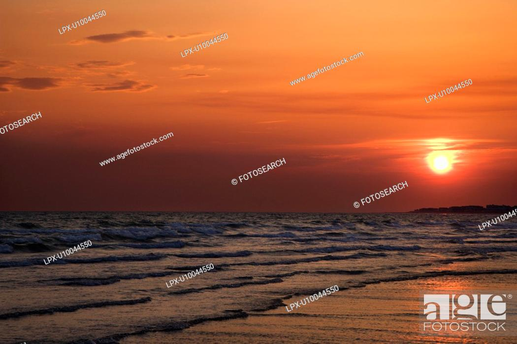 Stock Photo: Sun setting over beach on Bald Head Island, North Carolina.