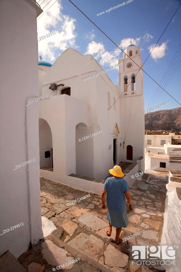 Stock Photo: Elderly local woman walking down the stairs in Artemonas village, Sifnos, Cyclades Islands, Greek Islands, Greece, Europe.