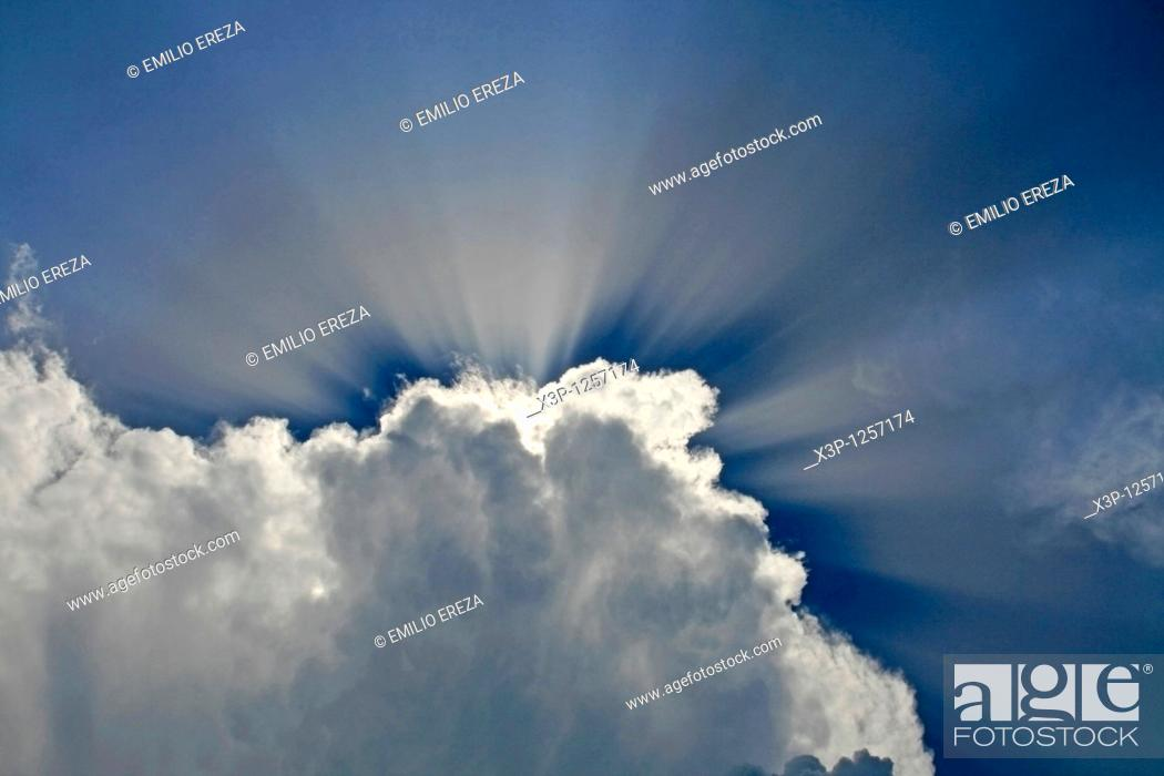 Stock Photo: Clouds and sunrays.