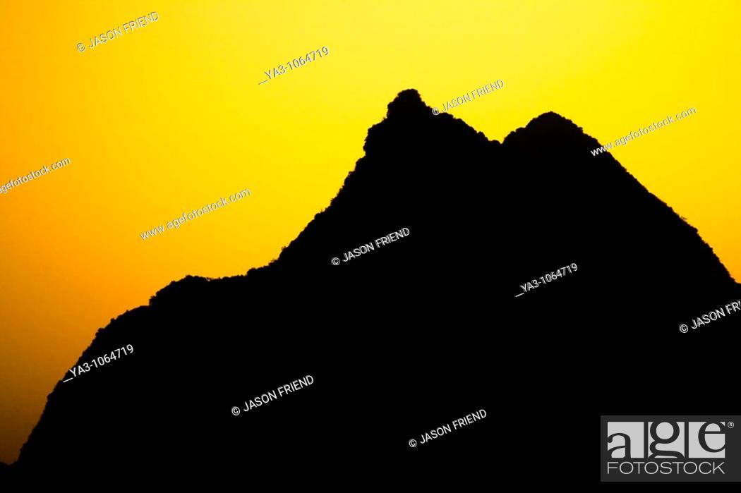 Stock Photo: China, Guangxi Zhuang Autonomous Region, Yangshuo County  Sunset behind a karst peak near the town of Yangshuo.