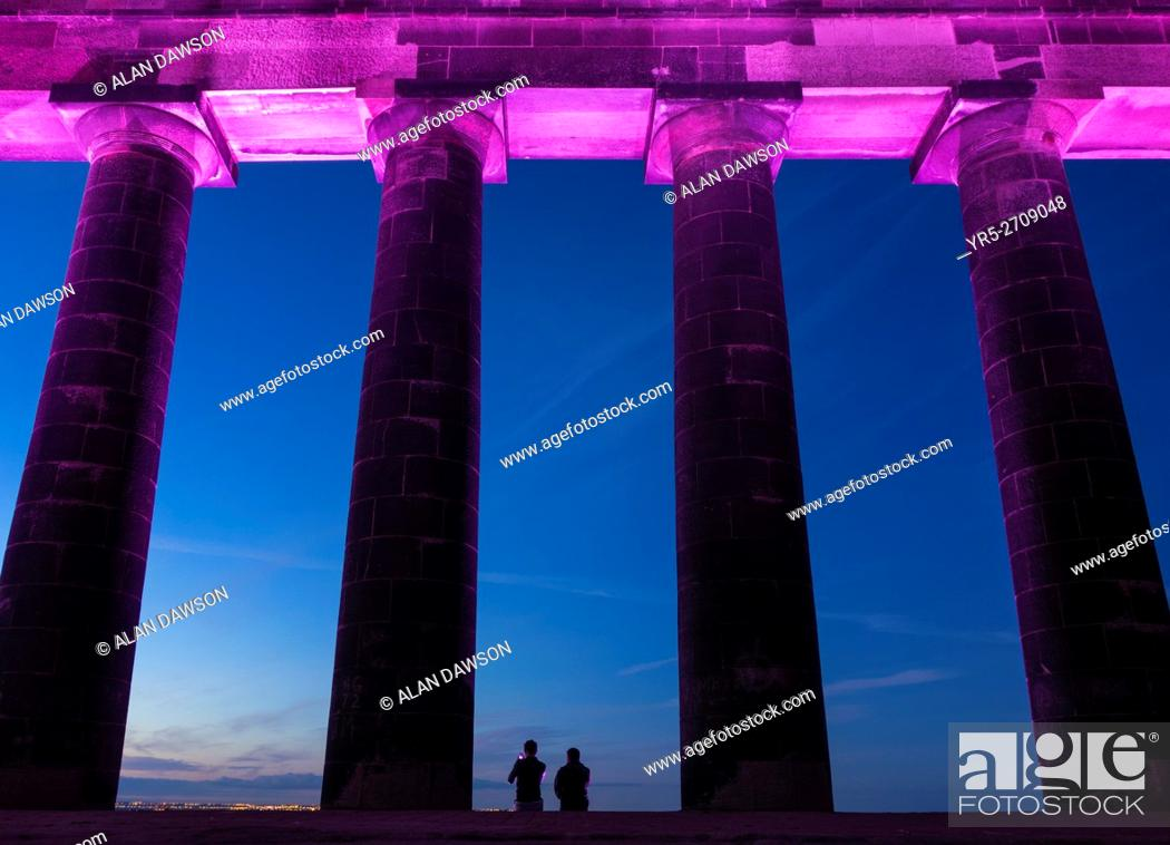Stock Photo: Penshaw Monument, Penshaw, Tyne & Wear, north east England, United Kingdom. Couple watching sunset from The Earl of Durham's Monument.