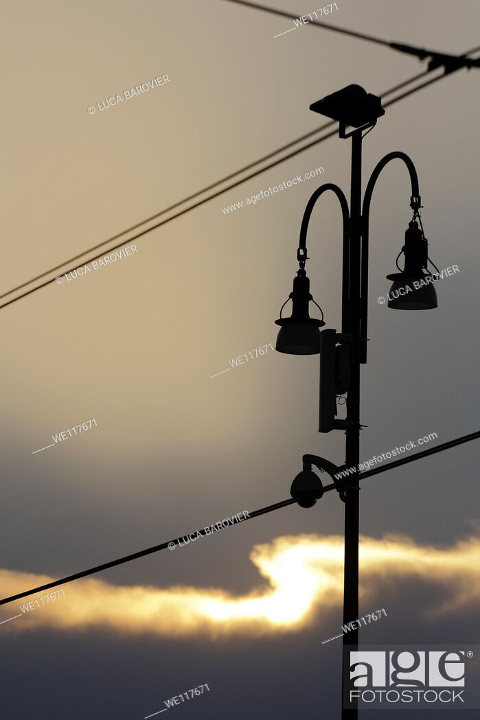 Stock Photo: Street lamp and tram cables - Milan, Italy.