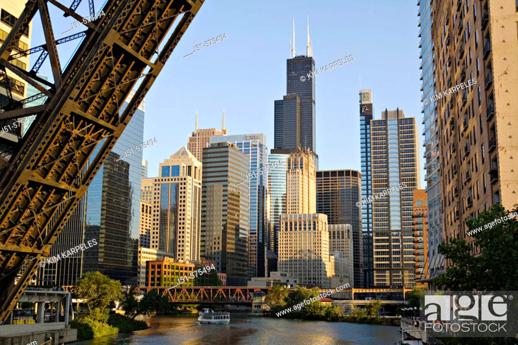 Stock Photo: Illinois. Chicago. Chicago River in downtown loop area of city, permanently upraised bridge over river, old railroad bridge, tour boat.