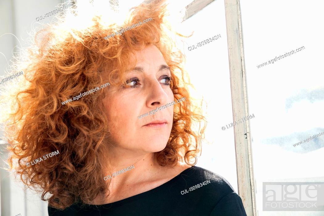 Stock Photo: Portrait of woman looking away.