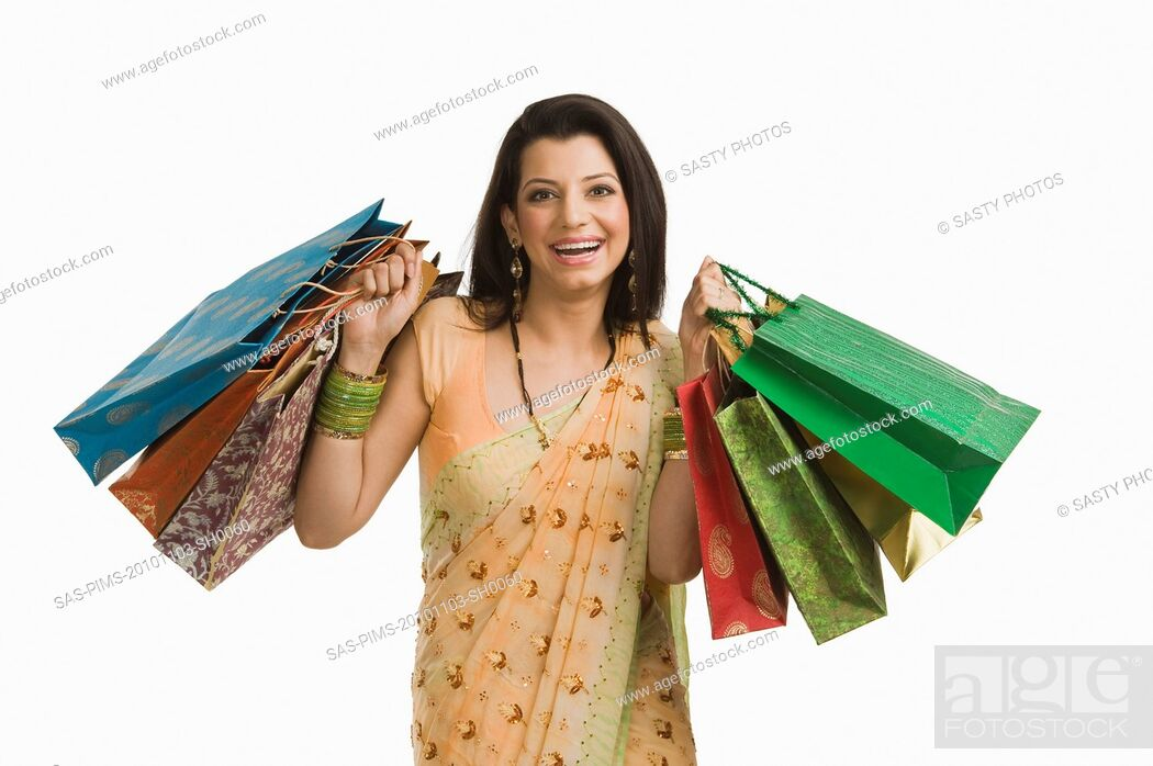 Stock Photo: Woman holding shopping bags.