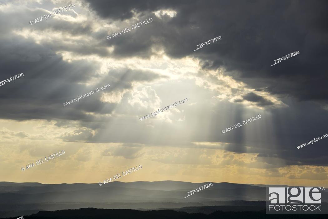 Stock Photo: Scenic of black pine tree tops and mountains with storm clouds Gudar mountains Teruel Aragon Spain.