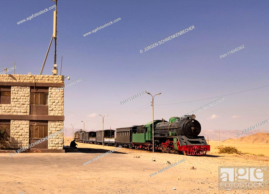 Stock Photo: This historic train at Wadi Rum station in Jordan is used today only for tourist purposes. But on the tracks at the edge of the desert also trains with.