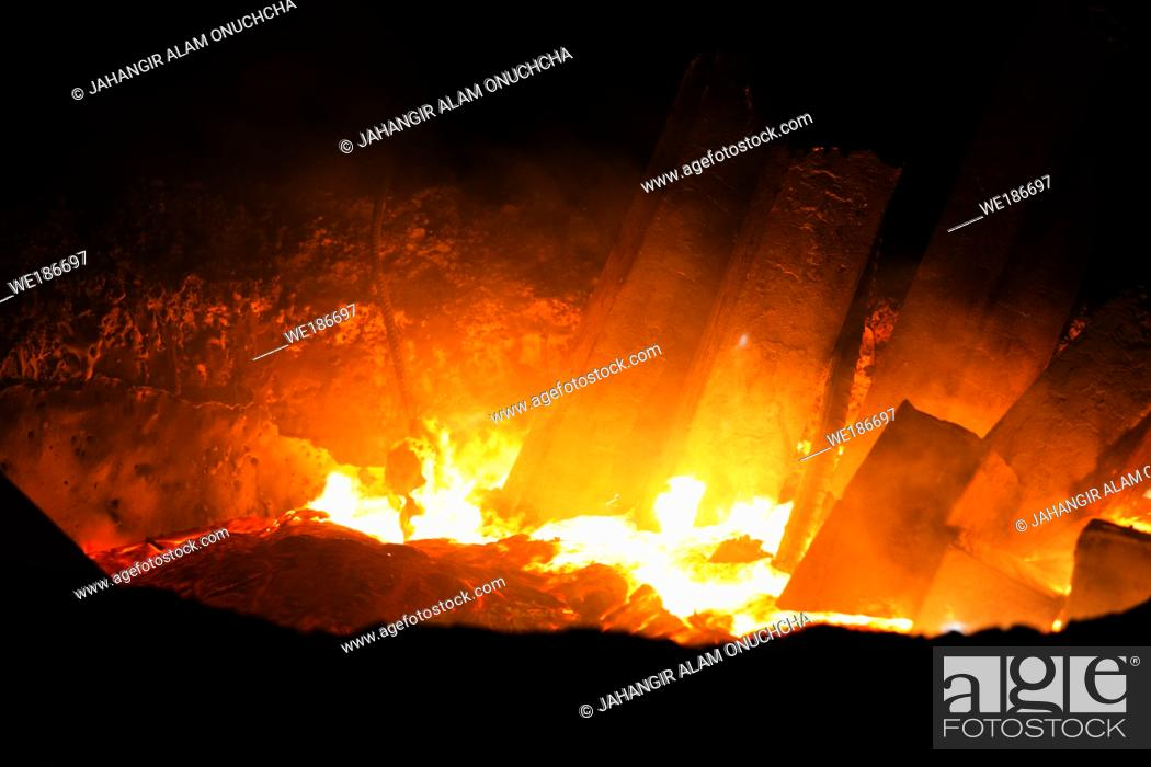 Stock Photo: Heated metal pig gets squeezed and drilled at special metal forging unit at Brueck metal forging factory in Demra, Dhaka, Bangladesh.