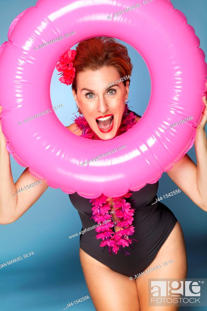Stock Photo: Woman with floating ring, smiling, portrait.